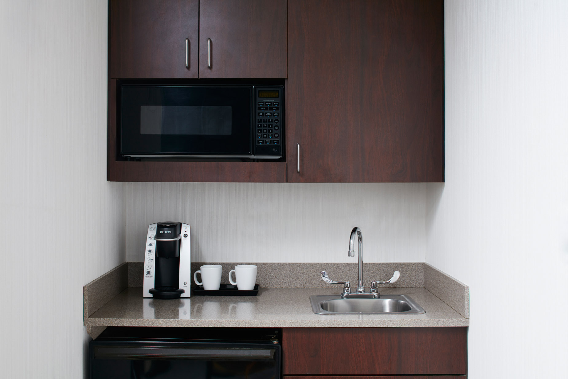 Hotel Kitchenette Wood Cabinet and Granite Counter top