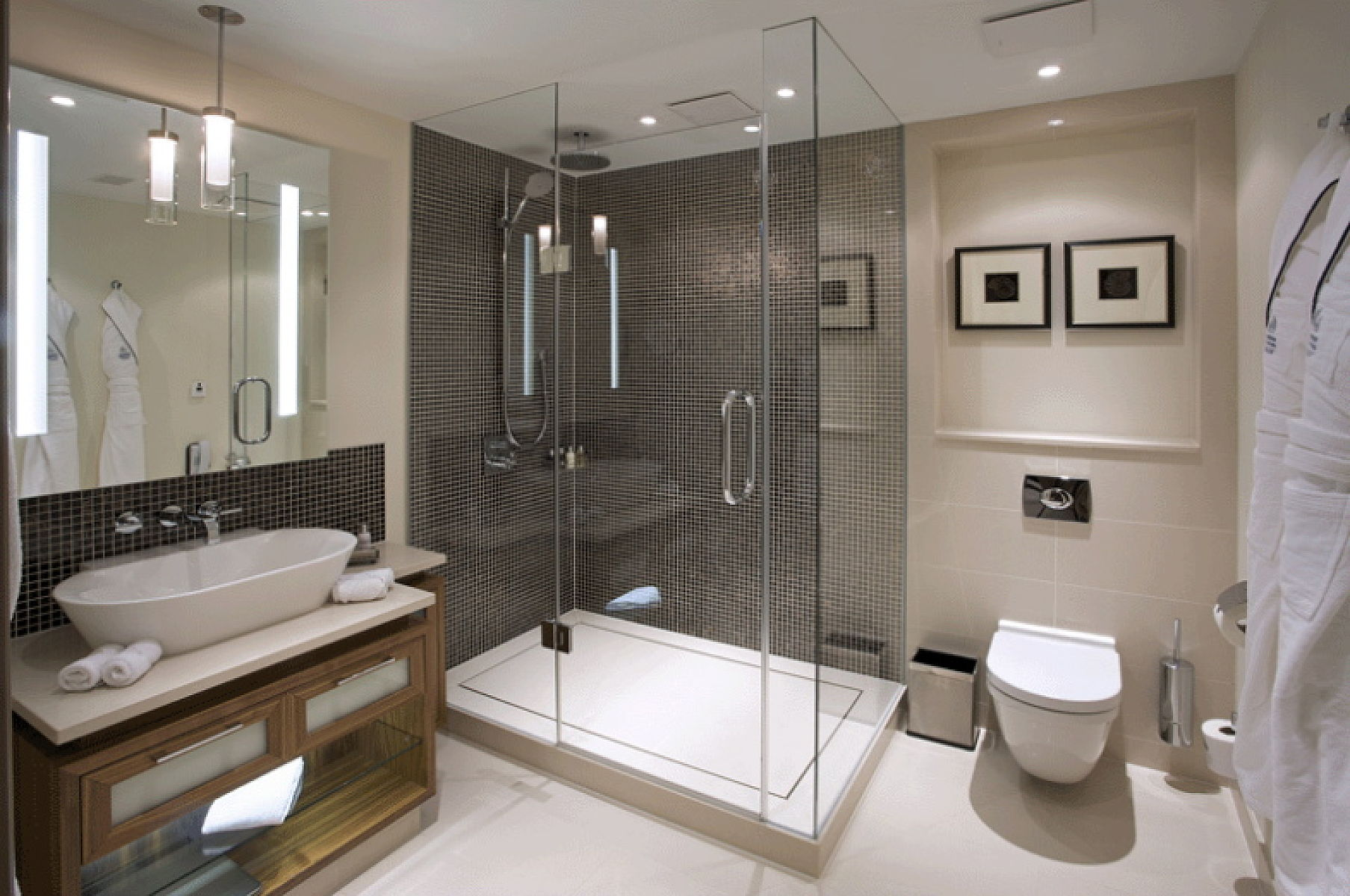 Hotel bathroom vanities with LED illuminated mirror and glass shower enclosure