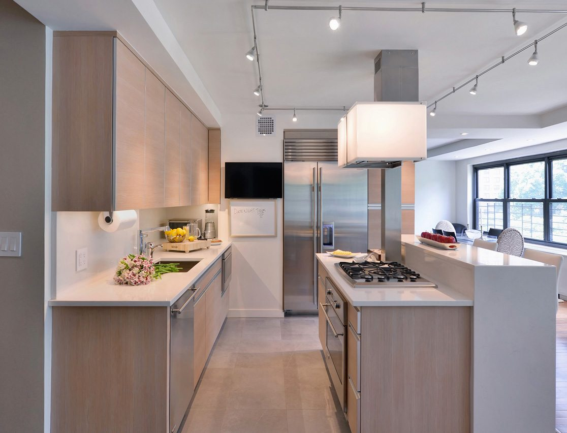 Frameless Apartment kitchen with white quartz counter top