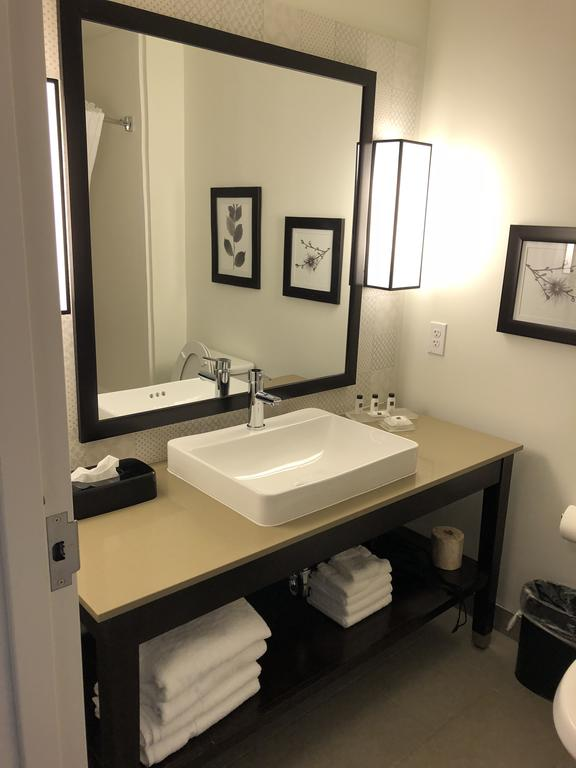 Country Inn and Suite bathroom vanities mirror and art shelf