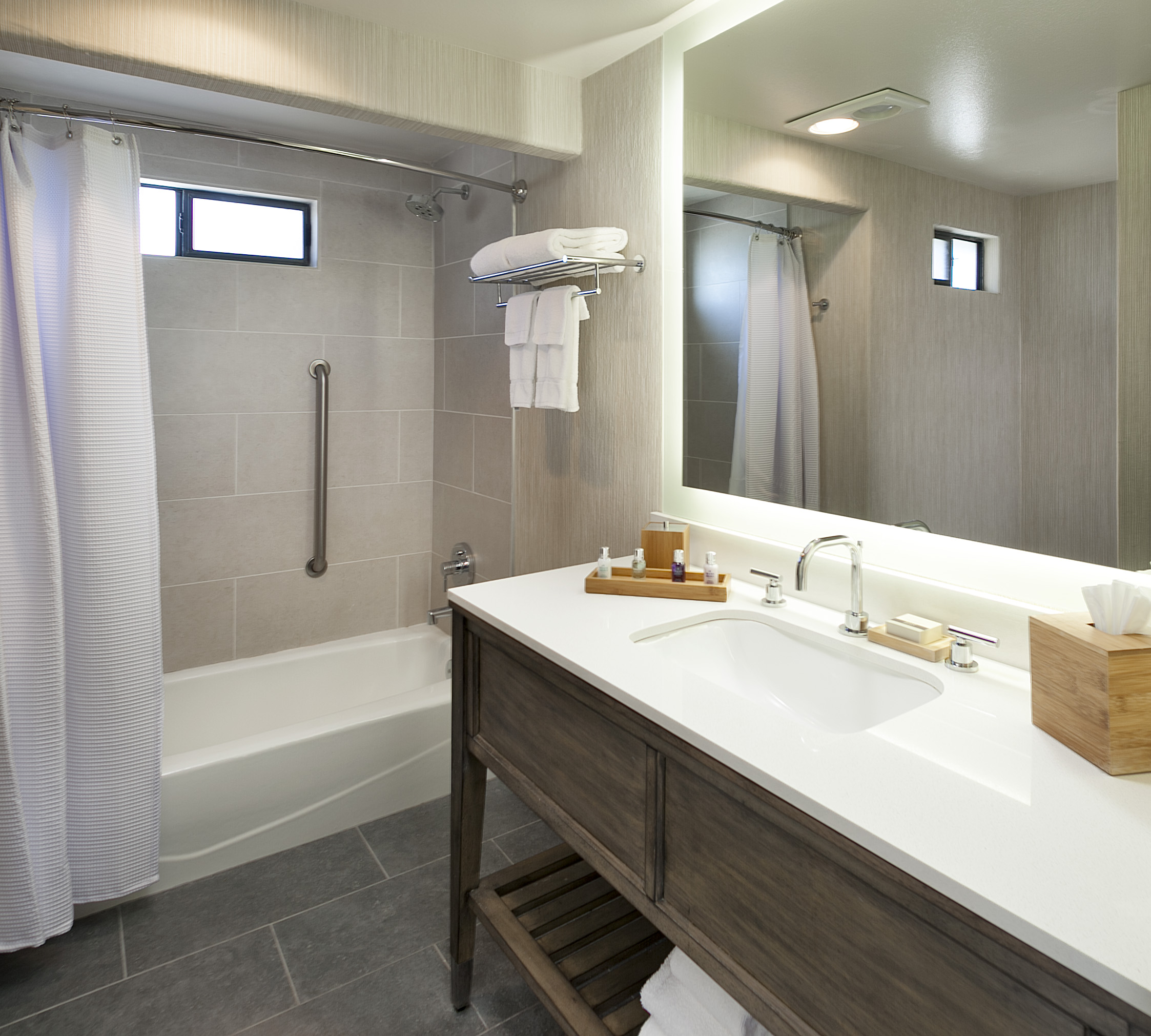 Hotel bathroom vanities with curved rod and shower trim kit