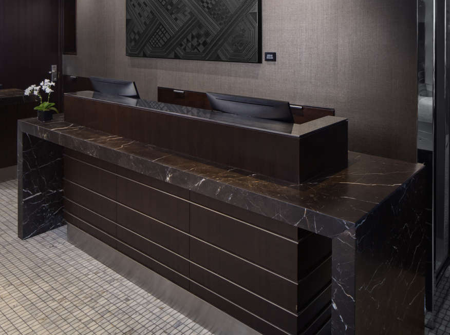 Hotel front desk by marble Saint Laurent